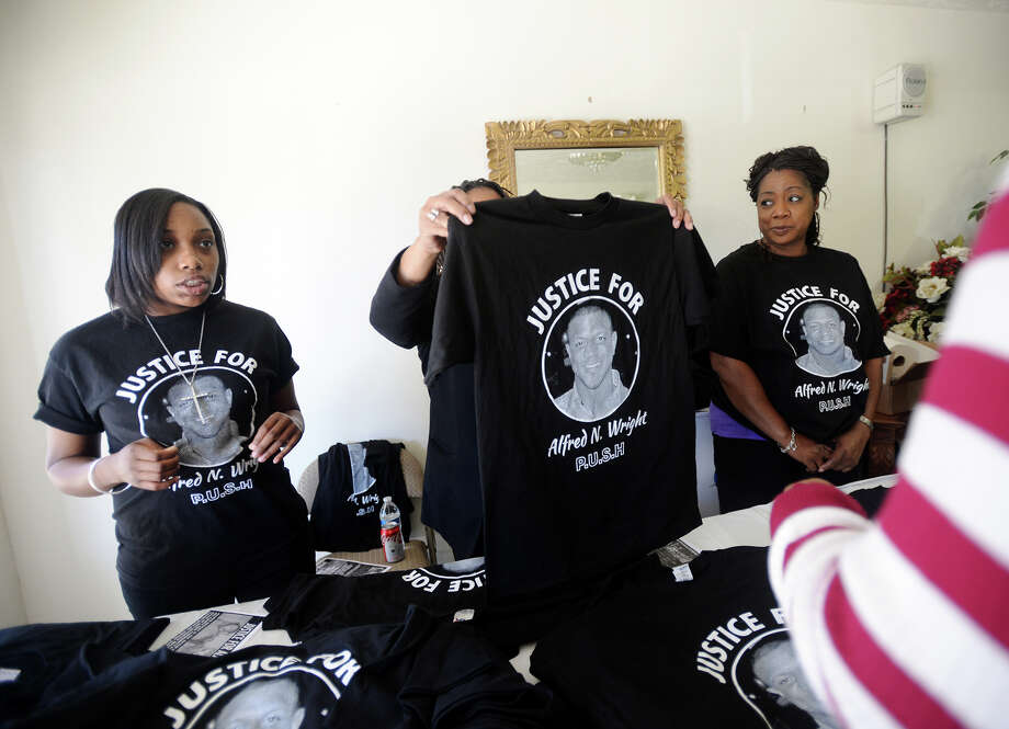 Elexus Grant, Bernadine Lewis Garland, and Kathy Lewis, left to right, sell shirts emblazoned with Alfred Wright's image Saturday. The family of Alfred Wright held another rally Saturday in Jasper to bring more attention to the mysterious disappearance and death of the healthcare worker last year in Sabine County. The rally included a panel discussion by several people, including the man who helped discover Wright's body. They concluded the service in Jasper with musical performances by Savion Wright, Alfred's brother and a former American Idol contestant, as well as Idol contestants John Fox and Madeline Patterson. After the event in Jasper, there was a rally in Sabine County. Photo taken Saturday, 2/15/14 Jake Daniels/@JakeD_in_SETX Photo: Jake Daniels / ©2013 The Beaumont Enterprise/Jake Daniels