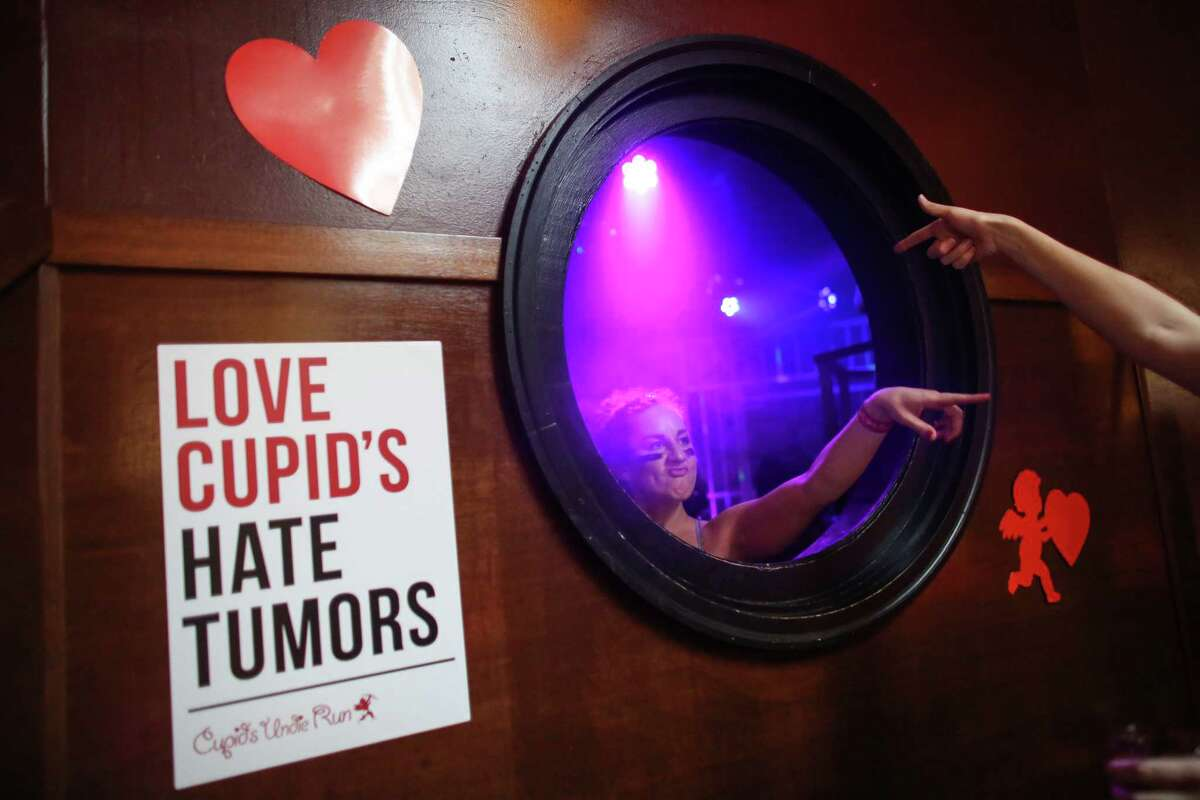 Participants talk through a porthole in the Ballroom during the third annual Cupid's Undie Run. The 1K run, walk and party helps money for the Children's Tumor Foundation. It also serves as an excuse for people to show off their nicest underwear.