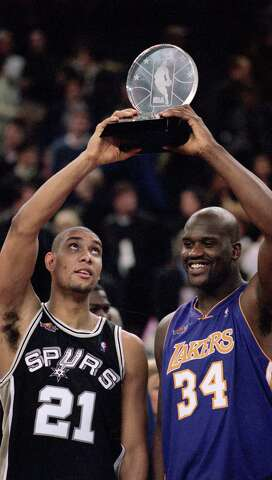 2c6ab91d596c Tim Duncan (21) and Shaquille O Neal shared the MVP after carrying the