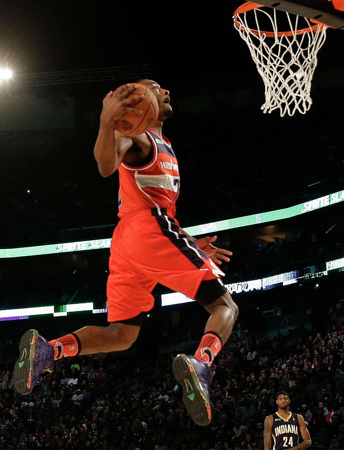 John Wall of the Washington Capitals participates in the slam dunk contest during the skills competition at the NBA All Star basketball game, Saturday, Feb. 15, 2014, in New Orleans. (AP Photo/Gerald Herbert) Photo: Gerald Herbert, Associated Press / AP