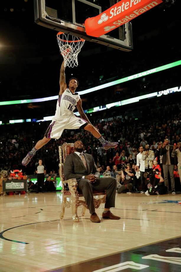 Ben McLemore of the Sacramento Kings dunks the ball as he flies over former NBA player Shaquille O'Neal during the skills competition at the NBA All Star basketball game, Saturday, Feb. 15, 2014, in New Orleans. (AP Photo/Gerald Herbert) Photo: Gerald Herbert, Getty Images / AP