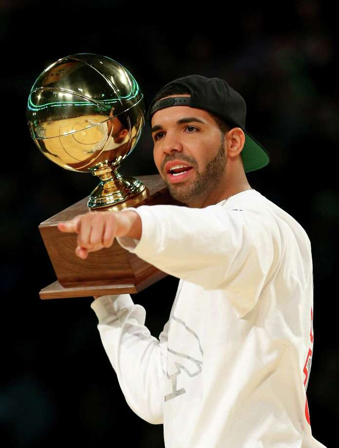 NEW ORLEANS, LA - FEBRUARY 15:  Drake carries the Sprite Slam Dunk Contest 2014 trophy before the contest as part of the 2014 NBA All-Star Weekend at the Smoothie King Center on February 15, 2014 in New Orleans, Louisiana. NOTE TO USER: User expressly acknowledges and agrees that, by downloading and or using this photograph, User is consenting to the terms and conditions of the Getty Images License Agreement. Photo: Ronald Martinez, Getty Images / 2014 Getty Images