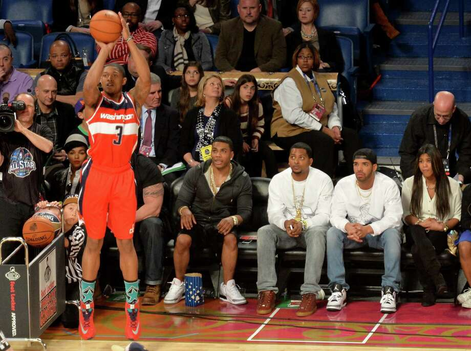 NEW ORLEANS, LA - FEBRUARY 15: Nelly and Drake attend the Foot Locker Three-Point Contest at the State Farm All-Star Saturday Night during the NBA All-Star Weekend 2014 at The Smoothie King Center on February 15, 2014 in New Orleans, Louisiana. Photo: Mike Coppola, Getty Images / 2014 Getty Images