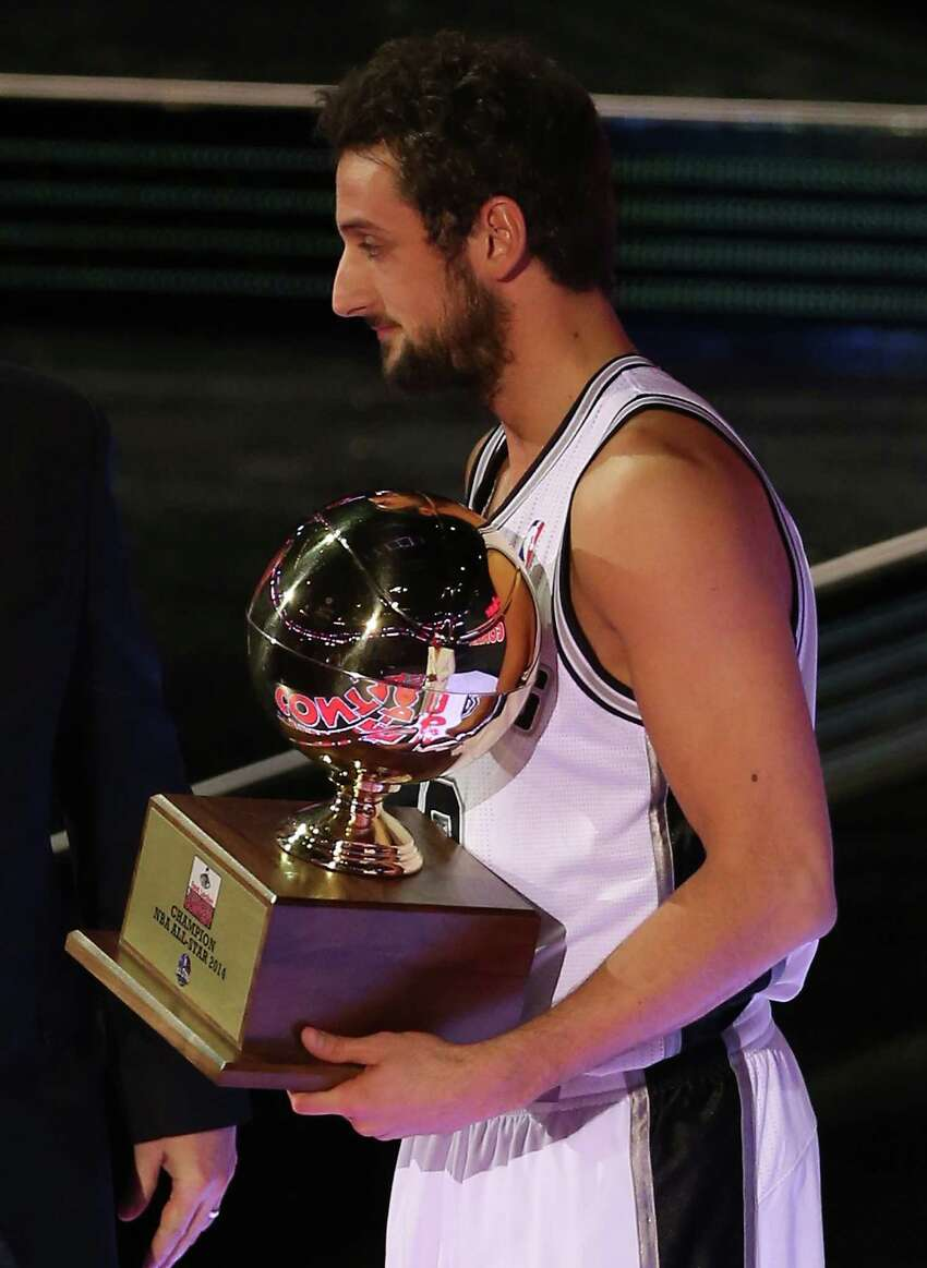 NEW ORLEANS, LA - FEBRUARY 15: Western Conference All-Star Marco Belinelli #3 of the San Antonio Spurs holds the trophy after he won the Foot Locker Three-Point Contest 2014 as part of the 2014 NBA All-Star Weekend at the Smoothie King Center on February 15, 2014 in New Orleans, Louisiana. NOTE TO USER: User expressly acknowledges and agrees that, by downloading and or using this photograph, User is consenting to the terms and conditions of the Getty Images License Agreement.