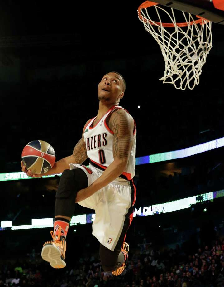 Damian Lillard of the Portland Train Blazers participates in the slam dunk contest during the skills competition at the NBA All Star basketball game, Saturday, Feb. 15, 2014, in New Orleans. (AP Photo/Gerald Herbert) Photo: Gerald Herbert, Getty Images / AP
