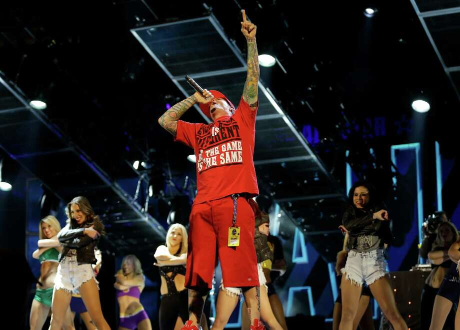 Singer Vanilla Ice performs at a break during the skills competition at the NBA All Star basketball game, Saturday, Feb. 15, 2014, in New Orleans. (AP Photo/Gerald Herbert) Photo: Gerald Herbert, Getty Images / AP