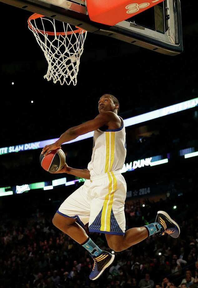 Paul George of the Indiana Pacers participates in the slam dunk contest during the skills competition at the NBA All Star basketball game, Saturday, Feb. 15, 2014, in New Orleans. (AP Photo/Gerald Herbert) Photo: Gerald Herbert, Getty Images / AP