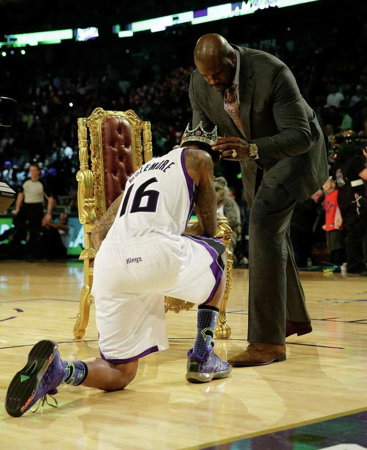 Ben McLemore of the Sacramento Kings receives a crown after dunking the ball over former NBA player Shaquille O'Neal during the skills competition at the NBA All Star basketball game, Saturday, Feb. 15, 2014, in New Orleans. (AP Photo/Gerald Herbert) Photo: Gerald Herbert, Getty Images / AP