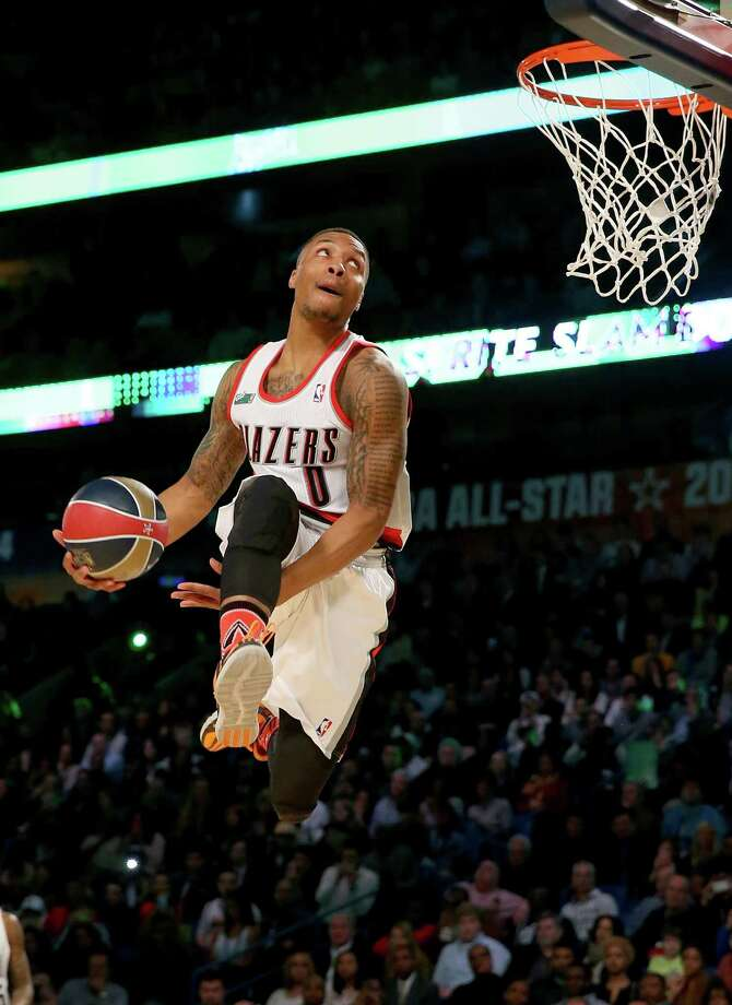 NEW ORLEANS, LA - FEBRUARY 15:  Western Conference All-Star Damian Lillard #0 of the Portland Trail Blazers competes in the Sprite Slam Dunk Contest 2014 as part of the 2014 NBA All-Star Weekend at the Smoothie King Center on February 15, 2014 in New Orleans, Louisiana. NOTE TO USER: User expressly acknowledges and agrees that, by downloading and or using this photograph, User is consenting to the terms and conditions of the Getty Images License Agreement. Photo: Ronald Martinez, Getty Images / 2014 Getty Images