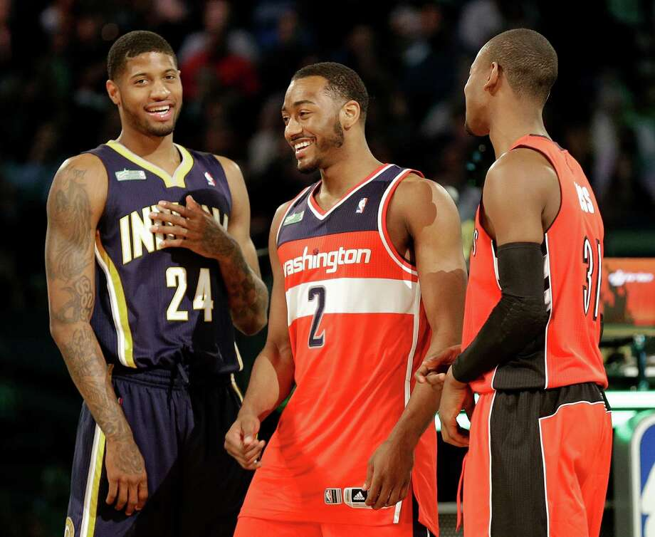 The winners of the slam dunk contest Paul George of the Indiana Pacers, John Wall of the Washington Capitals and Terrence Ross celebrate during the skills competition at the NBA All Star basketball game, Saturday, Feb. 15, 2014, in New Orleans. (AP Photo/Gerald Herbert) Photo: Gerald Herbert, Getty Images / AP