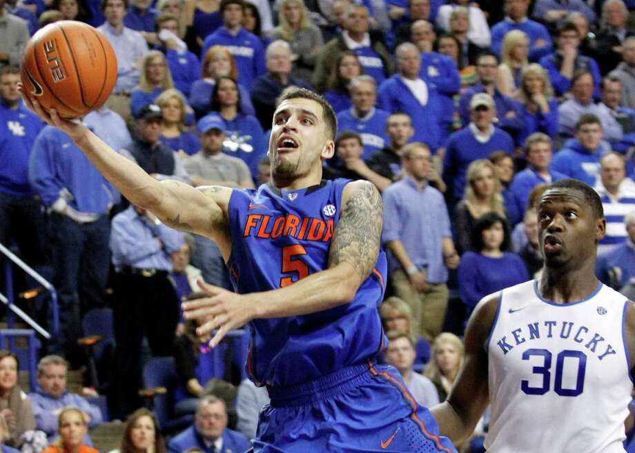 Florida's Scottie Wilbekin (5) shoots near Kentucky's Julius Randle (30) during the second half of an NCAA college basketball game on Saturday, Feb. 15, 2014, in Lexington, Ky. Florida won 69-59. (AP Photo/James Crisp) ORG XMIT: KYJC105 Photo: James Crisp / FR6426 AP