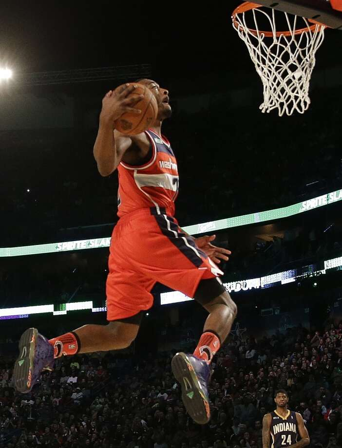 John Wall of the Washington Wizards participates in the slam dunk contest during the skills competition at the NBA All Star basketball game, Saturday, Feb. 15, 2014, in New Orleans. Photo: Gerald Herbert, Associated Press