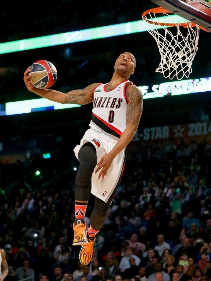 NEW ORLEANS, LA - FEBRUARY 15:  Western Conference All-Star Damian Lillard #0 of the Portland Trail Blazers competes in the Sprite Slam Dunk Contest 2014 as part of the 2014 NBA All-Star Weekend at the Smoothie King Center on February 15, 2014 in New Orleans, Louisiana. NOTE TO USER: User expressly acknowledges and agrees that, by downloading and or using this photograph, User is consenting to the terms and conditions of the Getty Images License Agreement.  (Photo by Ronald Martinez/Getty Images) Photo: Ronald Martinez, Getty Images