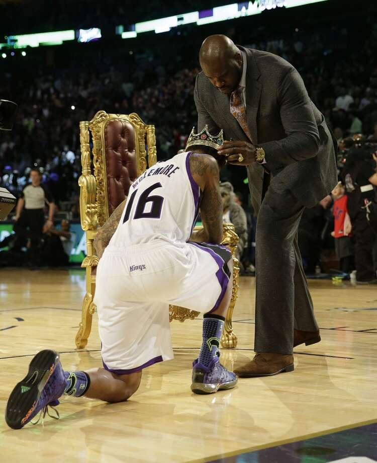 Ben McLemore of the Sacramento Kings receives a crown after dunking the ball over former NBA player Shaquille O'Neal during the skills competition at the NBA All Star basketball game, Saturday, Feb. 15, 2014, in New Orleans. (AP Photo/Gerald Herbert) Photo: Gerald Herbert, Associated Press