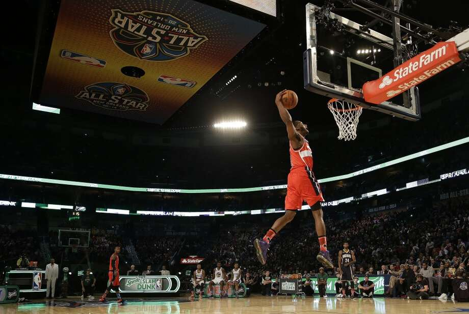 John Wall of the Washington Wizards participates in the slam dunk contest during the skills competition at the NBA All Star basketball game, Saturday, Feb. 15, 2014, in New Orleans. (AP Photo/Gerald Herbert) Photo: Gerald Herbert, Associated Press