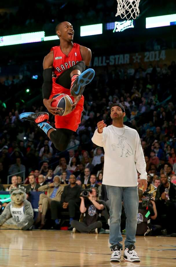 NEW ORLEANS, LA - FEBRUARY 15:  Eastern Conference All-Star Terrence Ross #31 of the Toronto Raptors takes the ball from Drake during the Sprite Slam Dunk Contest 2014 as part of the 2014 NBA All-Star Weekend at the Smoothie King Center on February 15, 2014 in New Orleans, Louisiana. NOTE TO USER: User expressly acknowledges and agrees that, by downloading and or using this photograph, User is consenting to the terms and conditions of the Getty Images License Agreement.  (Photo by Ronald Martinez/Getty Images) Photo: Ronald Martinez, Getty Images