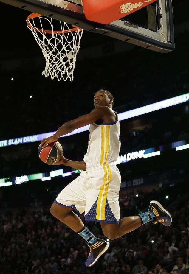 Paul George of the Indiana Pacers participates in the slam dunk contest during the skills competition at the NBA All Star basketball game, Saturday, Feb. 15, 2014, in New Orleans. (AP Photo/Gerald Herbert) Photo: Gerald Herbert, Associated Press