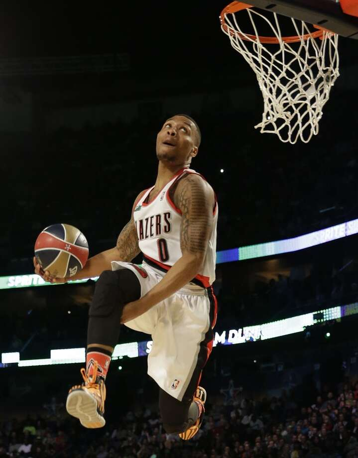 Damian Lillard of the Portland Train Blazers participates in the slam dunk contest during the skills competition at the NBA All Star basketball game, Saturday, Feb. 15, 2014, in New Orleans. (AP Photo/Gerald Herbert) Photo: Gerald Herbert, Associated Press