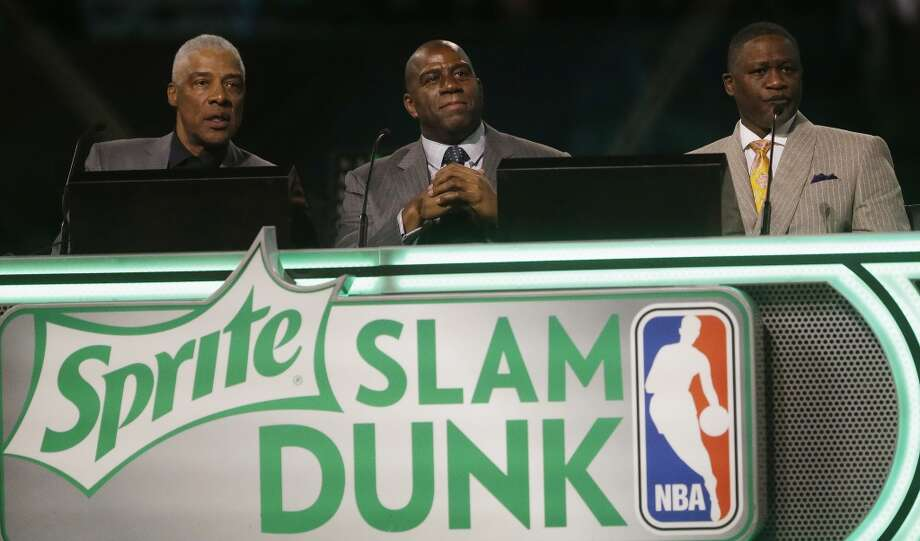 "Former NBA players' Julius Erving, Earvin ""Magic"" Johnson, Jr. and Dominique Wilkins judge the slam dunk contest during the skills competition at the NBA All Star basketball game, Saturday, Feb. 15, 2014, in New Orleans. (AP Photo/Gerald Herbert) Photo: Gerald Herbert, Associated Press"