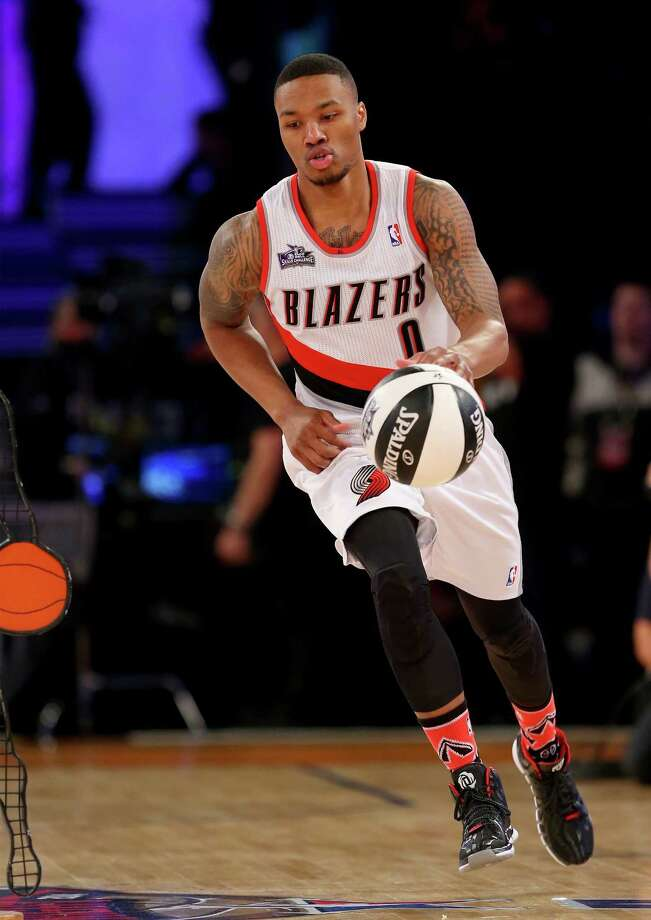 NEW ORLEANS, LA - FEBRUARY 15:  Western Conference All-Star Damian Lillard #0 of the Portland Trail Blazers competes in the Taco Bell Skills Challenge 2014 as part of the 2014 NBA All-Star Weekend at the Smoothie King Center on February 15, 2014 in New Orleans, Louisiana. NOTE TO USER: User expressly acknowledges and agrees that, by downloading and or using this photograph, User is consenting to the terms and conditions of the Getty Images License Agreement.  (Photo by Ronald Martinez/Getty Images) ORG XMIT: 465281609 Photo: Ronald Martinez / 2014 Getty Images