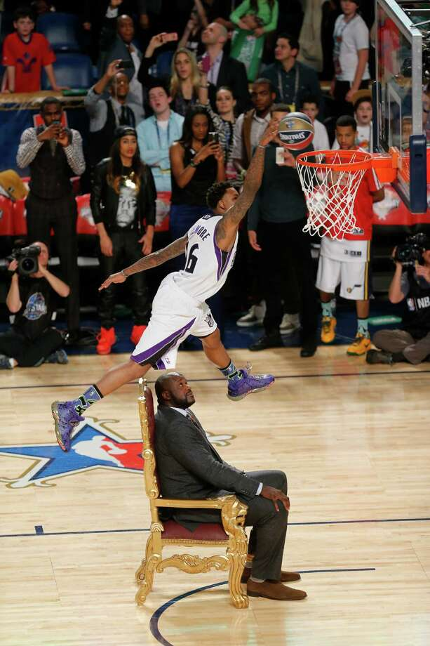 Ben McLemore of the Sacramento Kings dunks the ball as he flies over former NBA player Shaquille O'Neal during the skills competition at the NBA All Star basketball game, Saturday, Feb. 15, 2014, in New Orleans.  (AP Photo/Bill Haber) Photo: Bill Haber, Getty Images / FR170136 AP
