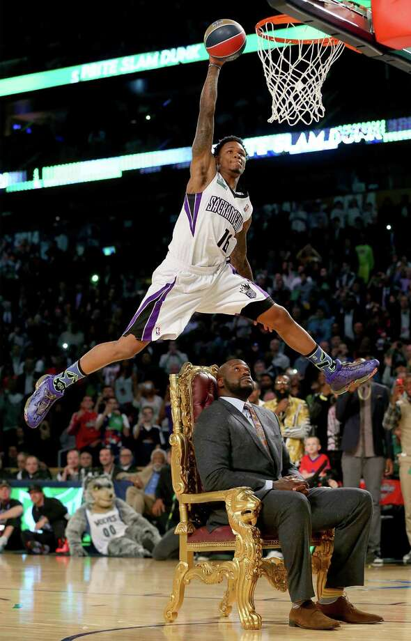 NEW ORLEANS, LA - FEBRUARY 15: Western Conference All-Star Ben McLemore #16 of the Sacramento Kings dunks the ball over Shaquille O'Neal during the Sprite Slam Dunk Contest 2014 as part of the 2014 NBA All-Star Weekend at the Smoothie King Center on February 15, 2014 in New Orleans, Louisiana. NOTE TO USER: User expressly acknowledges and agrees that, by downloading and or using this photograph, User is consenting to the terms and conditions of the Getty Images License Agreement. Photo: Ronald Martinez, Getty Images / 2014 Getty Images