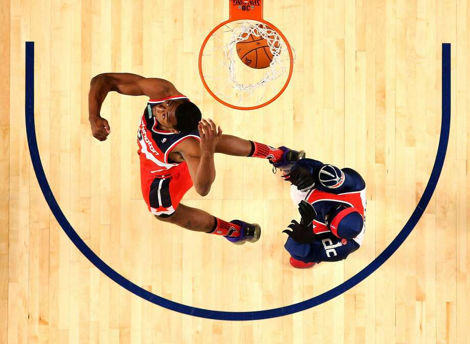 NEW ORLEANS, LA - FEBRUARY 15:  Eastern Conference All-Star John Wall #2 of the Washington Wizards competes in the Sprite Slam Dunk Contest 2014 as part of the 2014 NBA All-Star Weekend at the Smoothie King Center on February 15, 2014 in New Orleans, Louisiana. NOTE TO USER: User expressly acknowledges and agrees that, by downloading and or using this photograph, User is consenting to the terms and conditions of the Getty Images License Agreement.  (Photo by Ronald Martinez/Getty Images) Photo: Ronald Martinez, Getty Images