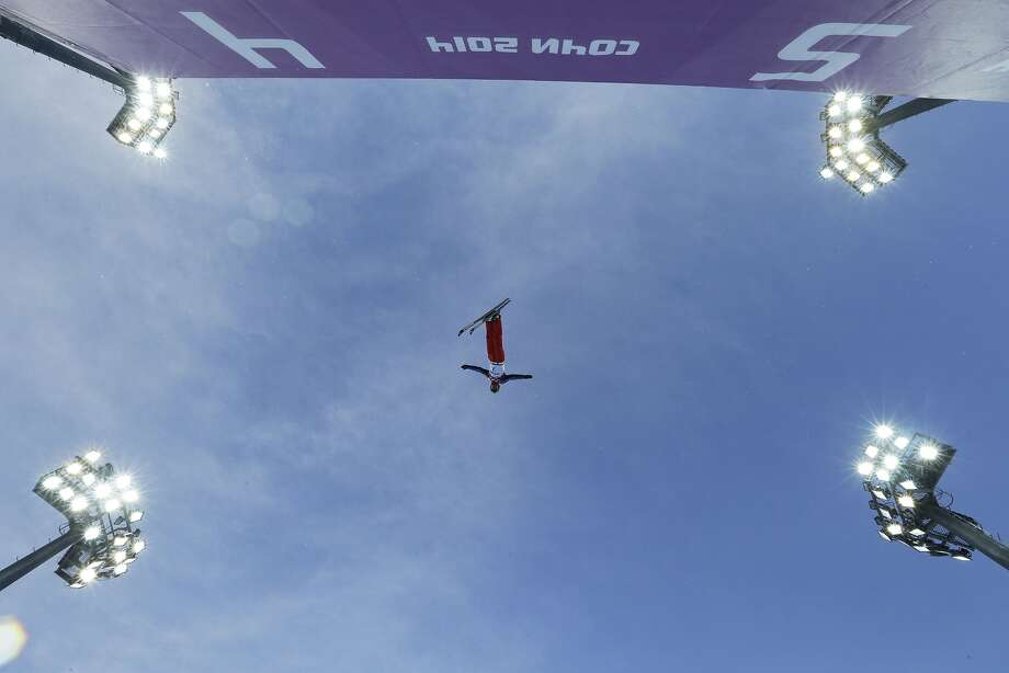 China's Wu Chao jumps during men's freestyle skiing aerials training at the Rosa Khutor Extreme Park, at the 2014 Winter Olympics, Saturday, Feb. 15, 2014, in Krasnaya Polyana, Russia. Photo: Andy Wong, Associated Press