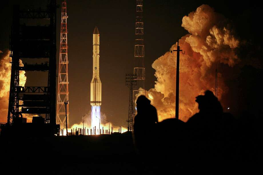 Turkish satellite hitches a ride: A Russian-built Proton-M rocket carrying a Turksat-4A Turkish communications satellite blasts off at the Russian-leased Cosmodrome in Baikonur, Kazakhstan. Photo: Stringer, AFP/Getty Images