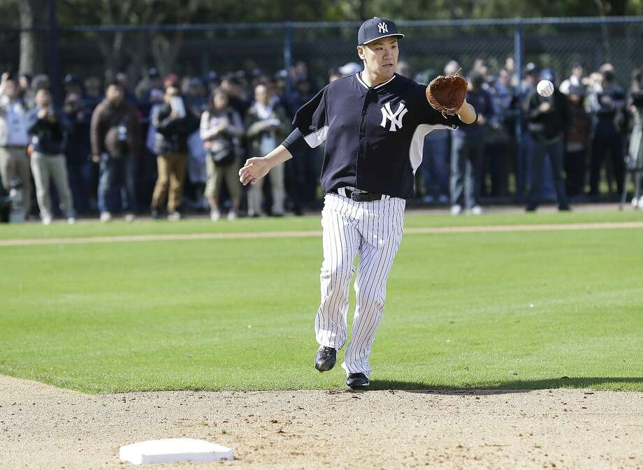 New York Yankees starting pitcher Masahiro Tanaka catches the ball as the covers first base during a drill in a spring training baseball practice Saturday, Feb. 15, 2014, in Tampa, Fla. (AP Photo/Charlie Neibergall) Photo: Charlie Neibergall, Associated Press