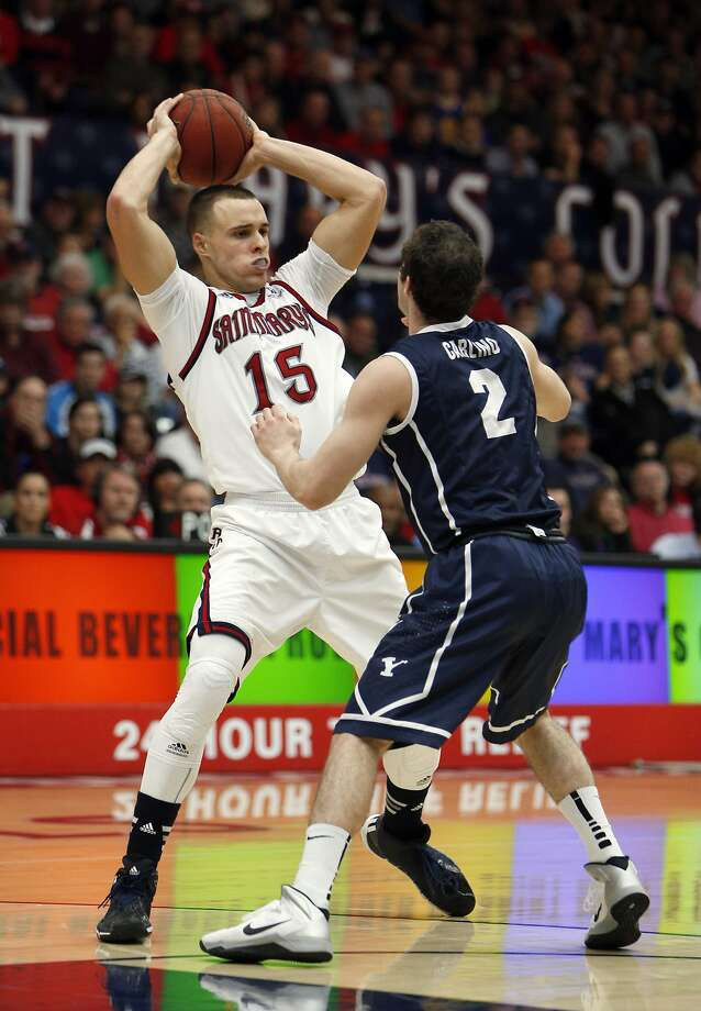 Gaels' Beau Levesque (15) tries to pass over Matt Carlino (2) in the second half. The Saint Mary's Gaels played the Brigham Young University Cougars at McKeon Pavilion in Moraga, Calif., on Saturday, February 15, 2014. Photo: Carlos Avila Gonzalez, The Chronicle