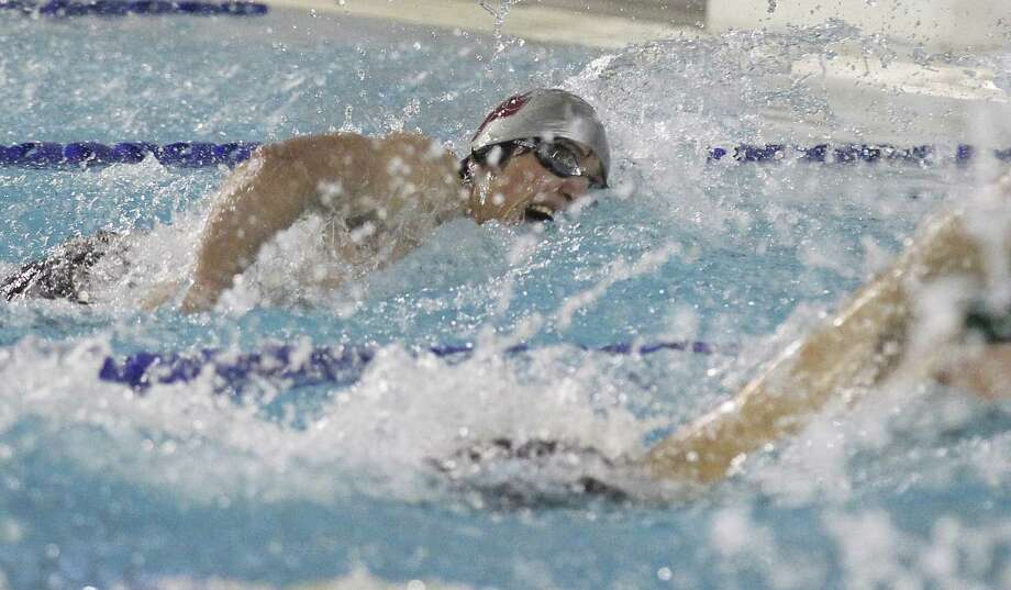 St. Anthony's Alek Barba sprints to a second-place finish in the 100-yard freestyle in 49.03 seconds at the TAPPS Division I state meet. He also took second in the 50 freestyle. Photo: Kin Man Hui, San Antonio Express-News / ©2014 San Antonio Express-News