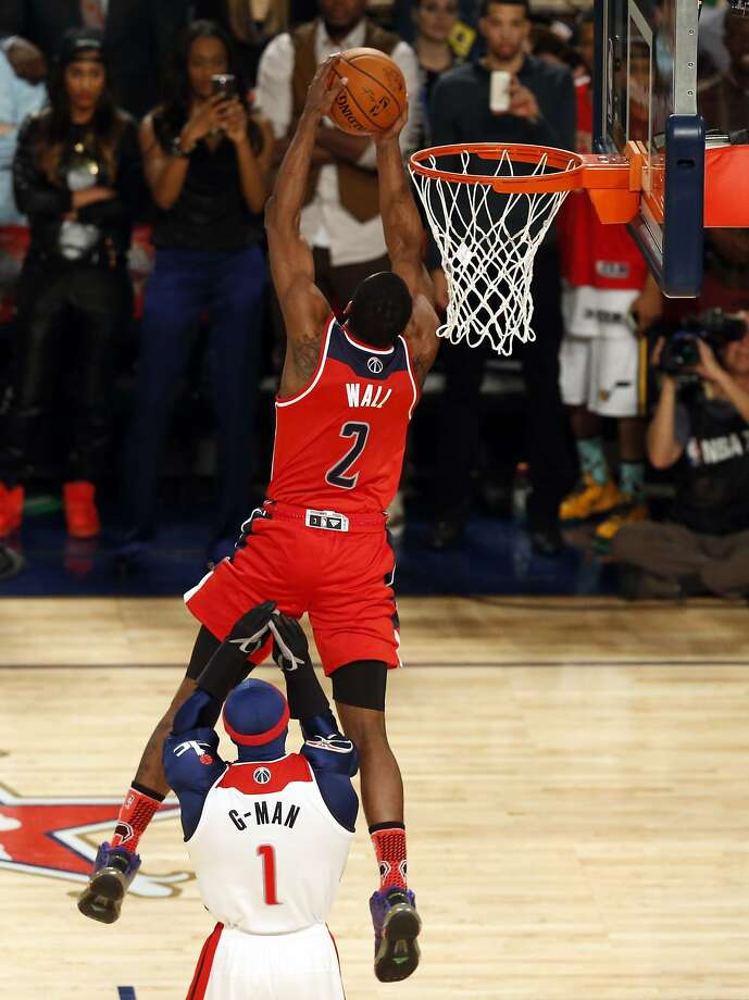 John Wall flies above the Wizards' mascot en route to earning top individual honors among dunkers. Photo: Derick Hingle, Reuters