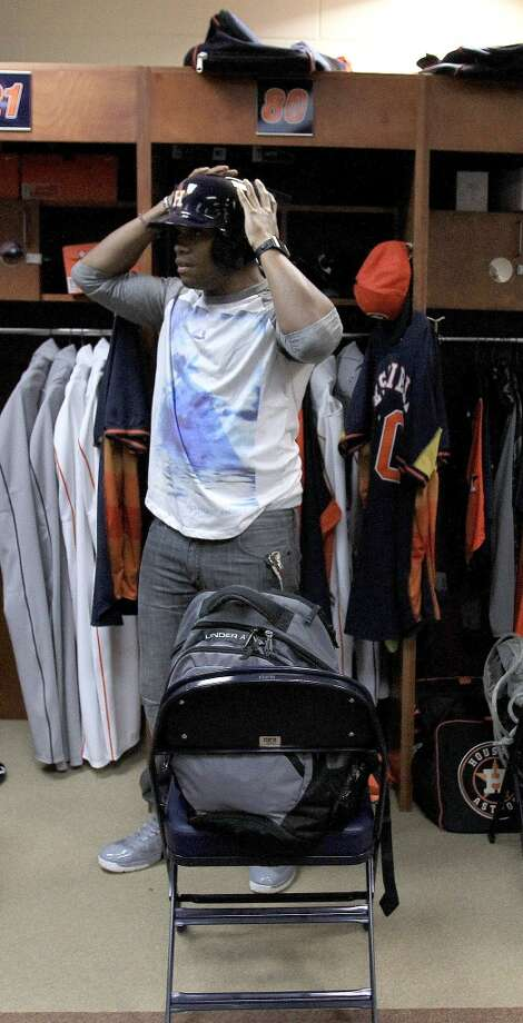 Outfielder Delino DeShields Jr. tries on his batting helmet in the clubhouse as pitchers and catchers report to spring training. Photo: Karen Warren, Houston Chronicle