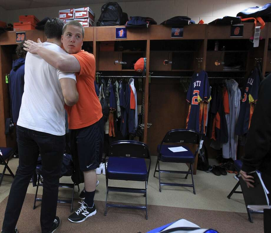 Catcher Jason Castro gets a hug from Matt Dominguez, facing camera, in the clubhouse as pitchers and catchers report to spring training. Photo: Karen Warren, Houston Chronicle