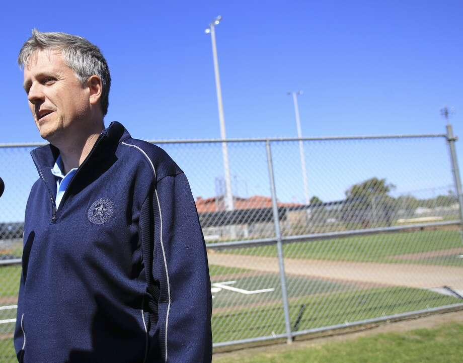 Astros General Manager Jeff Luhnow talks to reporters outside of the clubhouse as pitchers and catchers reported to spring training. Photo: Karen Warren, Houston Chronicle