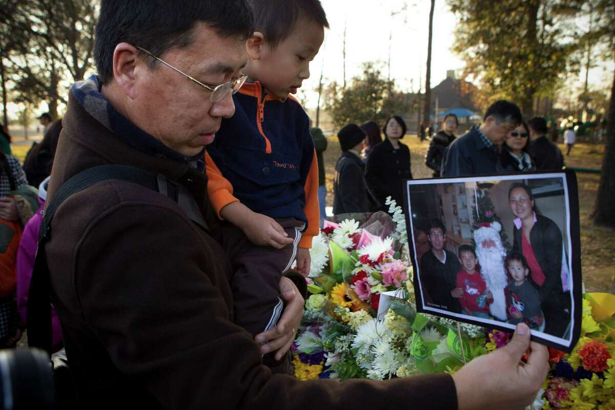 """'Baffling' Cypress family's assassination The January 2014 shooting deaths of Maoye Sun,50, his wife, Mei Xie, 49, and their two young sons in their Cypress home made headlines around the globe and shook Houston's Chinese-American community. The family was found dead about 7:30 p.m. Jan. 30 in their home in the 14000 block of Fosters Creek Drive. Authorities said the couple was last seen on Jan. 24. The boys, Timothy Xie Sun, 9, and Titus Xiao Sun, 7, last attended school at Sampson Elementary the day before. Different theories have swirled around the crime, like a case of mistaken identity or a contract killing. News reports abroad popped out stories about a murder arranged overseas. But investigators won't join in the speculation about possible motives or any specific theories. Declaring the case """"baffling,"""" Harris County Sheriff Adrian Garcia met in March with the area's Chinese and Taiwanese communities to announce a billboard campaign aimed at getting clues. """"My office is dedicating all resources available to help find those responsible,"""" he said. """"I'm asking for your support to communicate about the circumstances surrounding this crime."""" Gan Yao, pictured above, carries a photo of the Sun family during a vigil Feb. 8, 2014, in Houston.HoustonChronicle.com: Six months later, no closer to an arrest"""