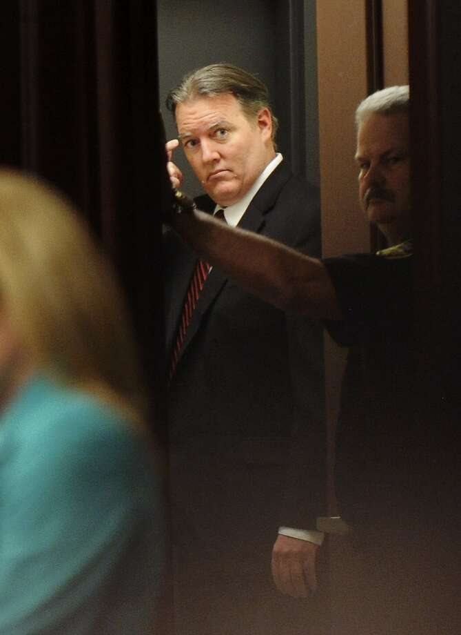 Michael Dunn looks back into the courtroom after the verdicts were announced Saturday night. Photo: Pool, Reuters