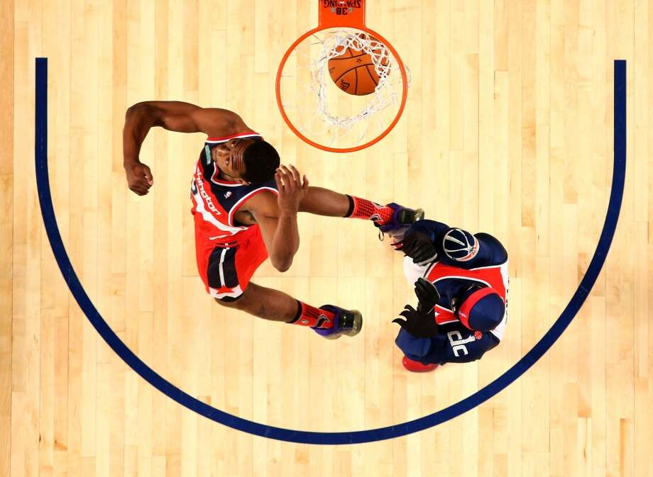 2014: John Wall    Location: New Orleans Team: Washington Wizards  Note: Wall was voted the dunker of the night by the fans. Wall, Indiana's Paul George and Toronto's Terrence Ross won the team dunking competition. Photo: Ronald Martinez, Getty Images