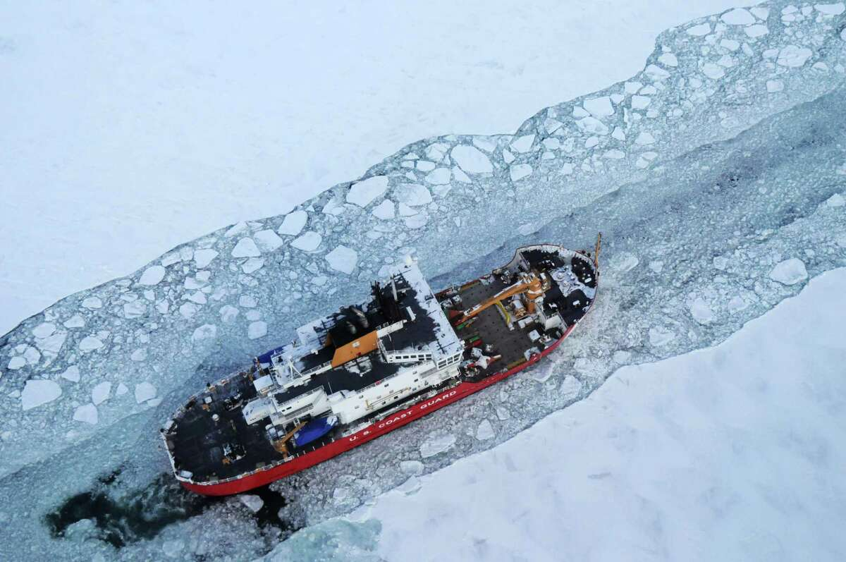 In this Dec. 26, 2013 photo provided by the U.S. Coast Guard the icebreaker Mackinaw maintains a shipping lane on the St. Marys River linking Lakes Superior and Huron. It�s been so bitterly cold for so long in the Upper Midwest that the Great Lakes are almost completely covered with ice. The last time they came this close was in 1994, when 94 percent of the lakes� surface was frozen. (AP Photo/U.S. Coast Guard