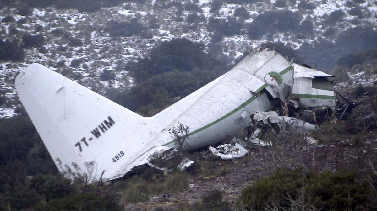 The wreckage of an Algerian military transport plane which slammed into a mountain Tuesday in the country's rugged eastern region, is pictured Wednesday, Feb. 12, 2014. The crash killed scores of people and left just one survivor, the defense ministry said. The plane was discovered in pieces on Mount Fortas near the town of Ain Kercha, 50 kilometers (30 miles) southeast of Constantine, the main city in eastern Algeria.