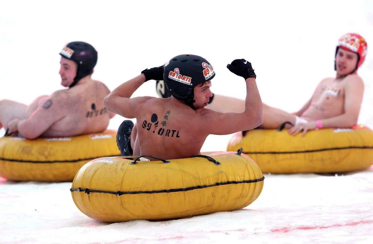 World news photos: Apathy protest, naked sledding and more