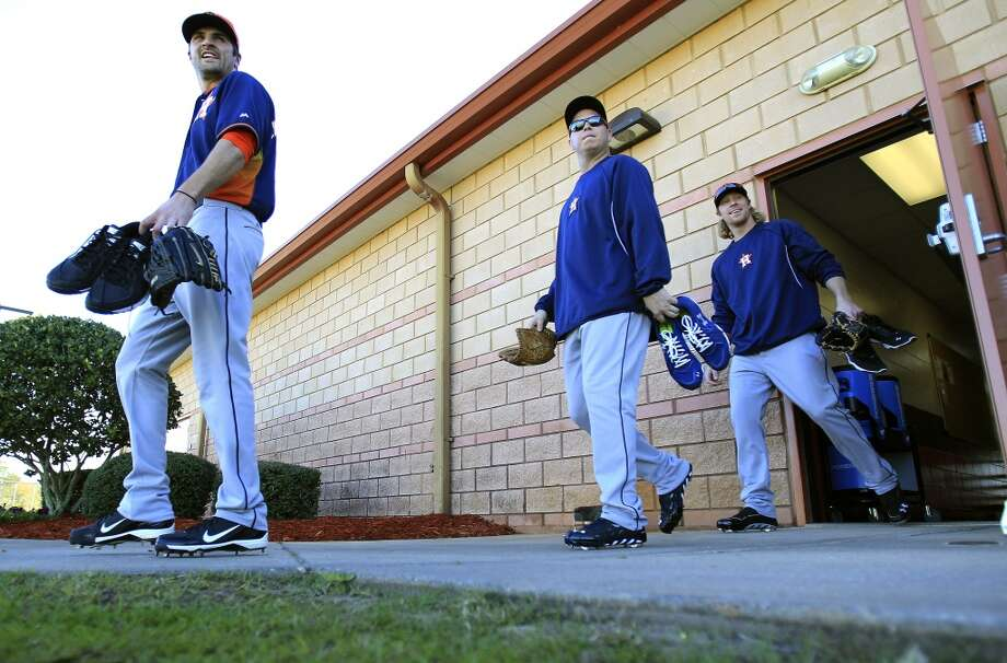 Pitchers walk out of the clubhouse during the first day of workouts for pitchers and catchers at the Astros spring training facility on Sunday. Photo: Karen Warren, Houston Chronicle
