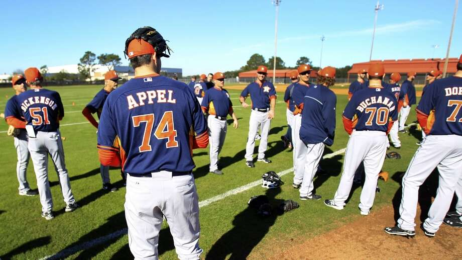 Houston Astros RHP Mark Appel (74) prepares to stretch with teammates during the first day of workouts for pitchers and catchers Photo: Karen Warren, Houston Chronicle