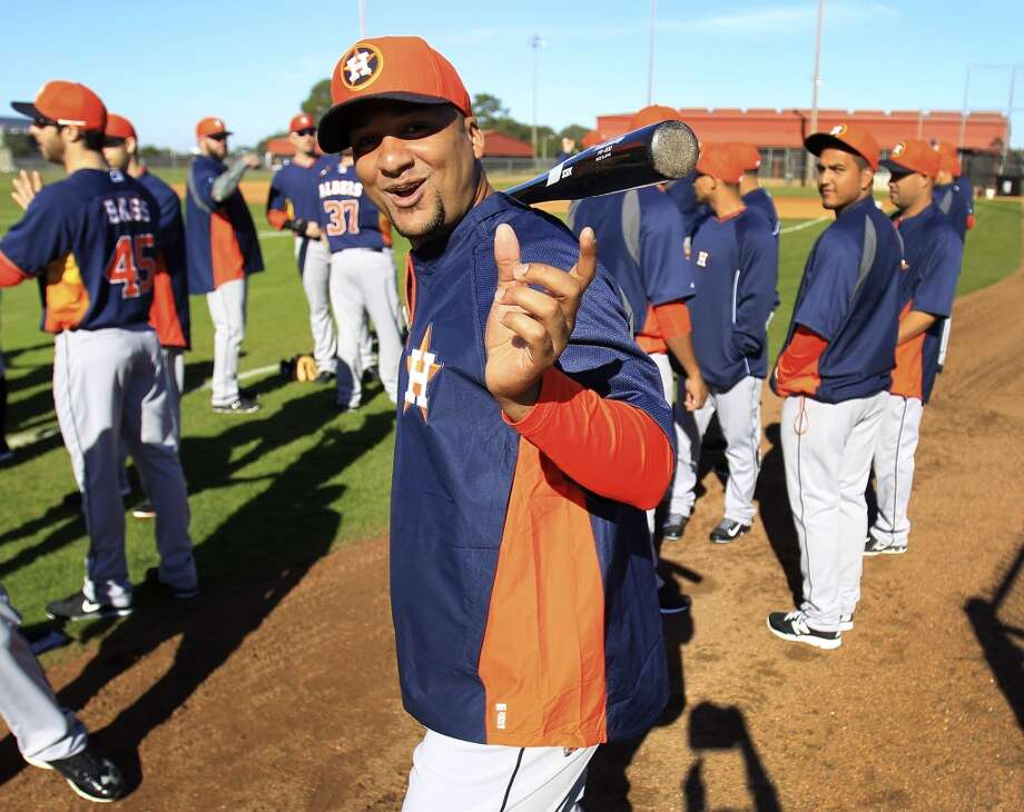 catcher Carlos Corporan hams it up before the start of the first day of workouts for pitchers and catchers. Photo: Karen Warren, Houston Chronicle