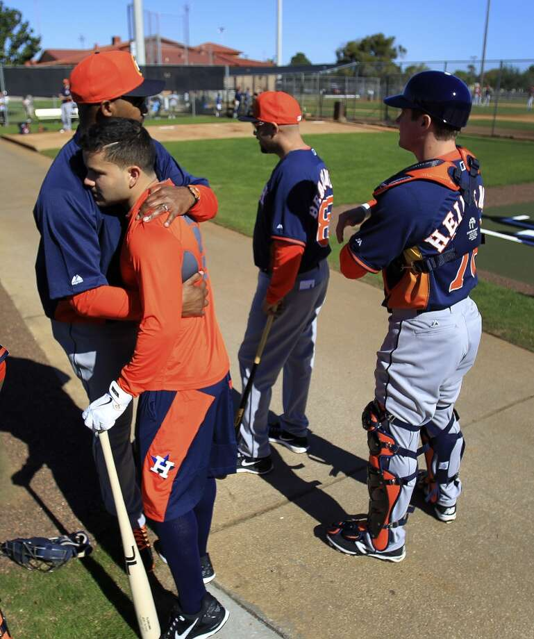 Astros manager Bo Porter gives Jose Altuve a hug during the first day of workouts for pitchers and catchers. Photo: Karen Warren, Houston Chronicle