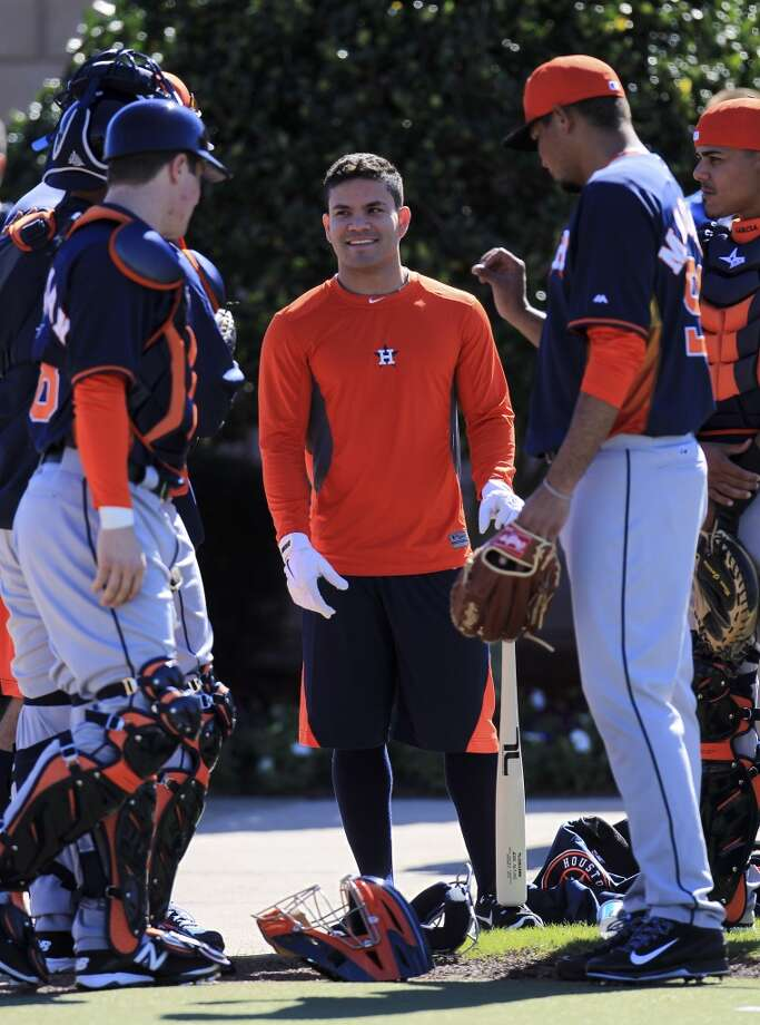 Jose Altuve greets his fellow teammates during the first day of workouts for pitchers and catchers. Photo: Karen Warren, Houston Chronicle