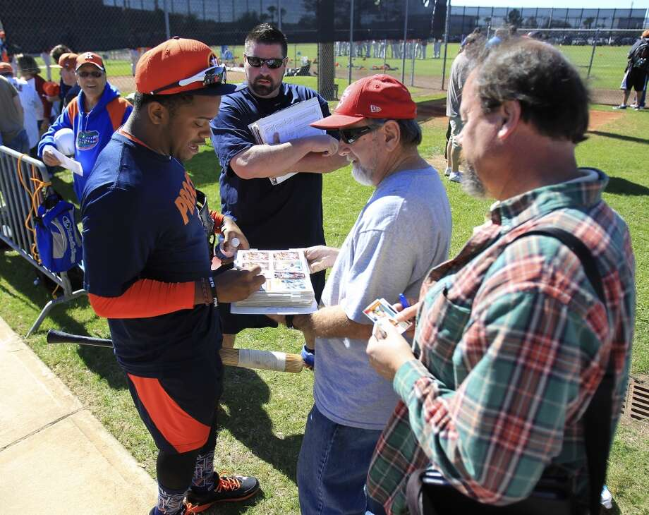 Delino DeShields Jr. signs autographs as he heads off to work out with other early-arriving position players. Photo: Karen Warren, Houston Chronicle