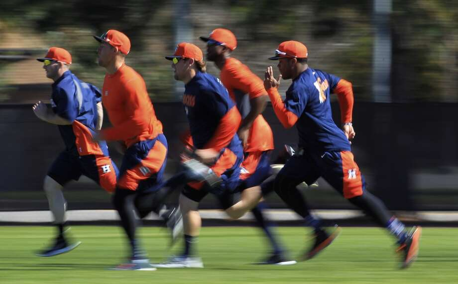 Early-arriving position players run to warm up for their workouts. Photo: Karen Warren, Houston Chronicle