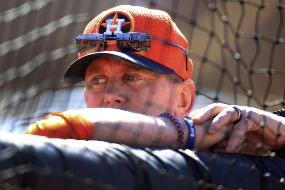 Astros hitting coach John Mallee watches batting practice during workouts for early-arriving position players. Photo: Karen Warren, Houston Chronicle